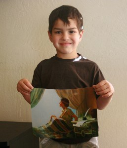 holding picture of the boy samuel
