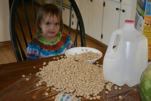 pouring her own cereal