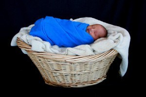 Jason swaddled in basket  full