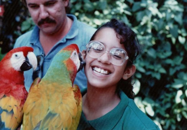 montse-getting-a-kiss-from-a-parrot