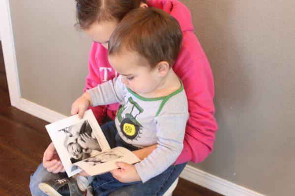 child looking at chatbook photo book